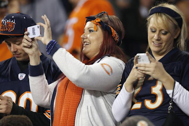 Chicago Bears fans take in he action in the first half of the Bears' NFL football game against the New York Giants, Thursday, Oct. 10, 2013, in Chicago. (AP Photo/Charles Rex Arbogast)