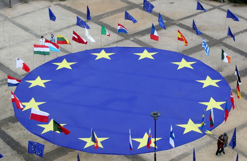 FILE PHOTO: EU flag lies at Schuman square on eve of Europe Day in Brussels