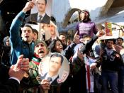 FILE PHOTO: Supporters of Syria's President Bashar al-Assad attend a rally in Damascus