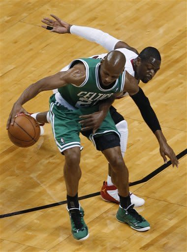 Boston Celtics' Ray Allen (20) defends the ball from Miami Heat's Dwyane Wade during the first half of Game 7 of the NBA basketball playoffs Eastern Conference finals, Saturday, June 9, 2012, in Miami. (AP Photo/Wilfredo Lee)