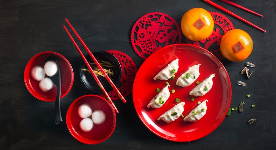 Fruit and dumplings are also symbols of luck and prosperity (Getty)