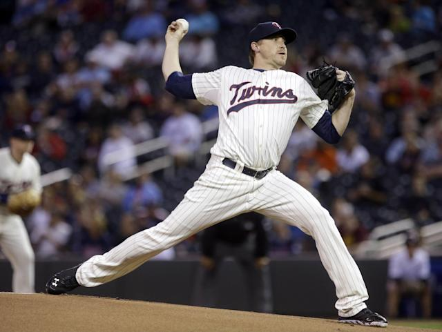 Minnesota Twins pitcher Kevin Correia throws against the Detroit Tigers during the first inning of a baseball game, Wednesday, Sept. 25, 2013, in Minneapolis. (AP Photo/Jim Mone)