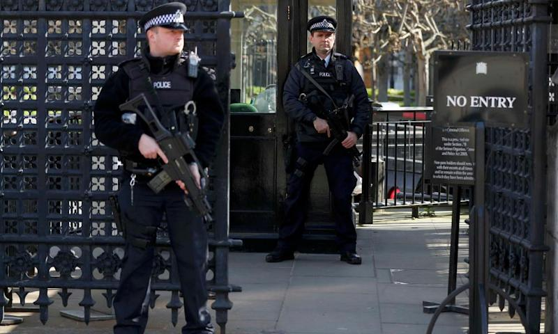 Armed police outside an entrance to the Houses of Parliament yesterday. Last week's attack has cast doubt over arrangements for restoration work.