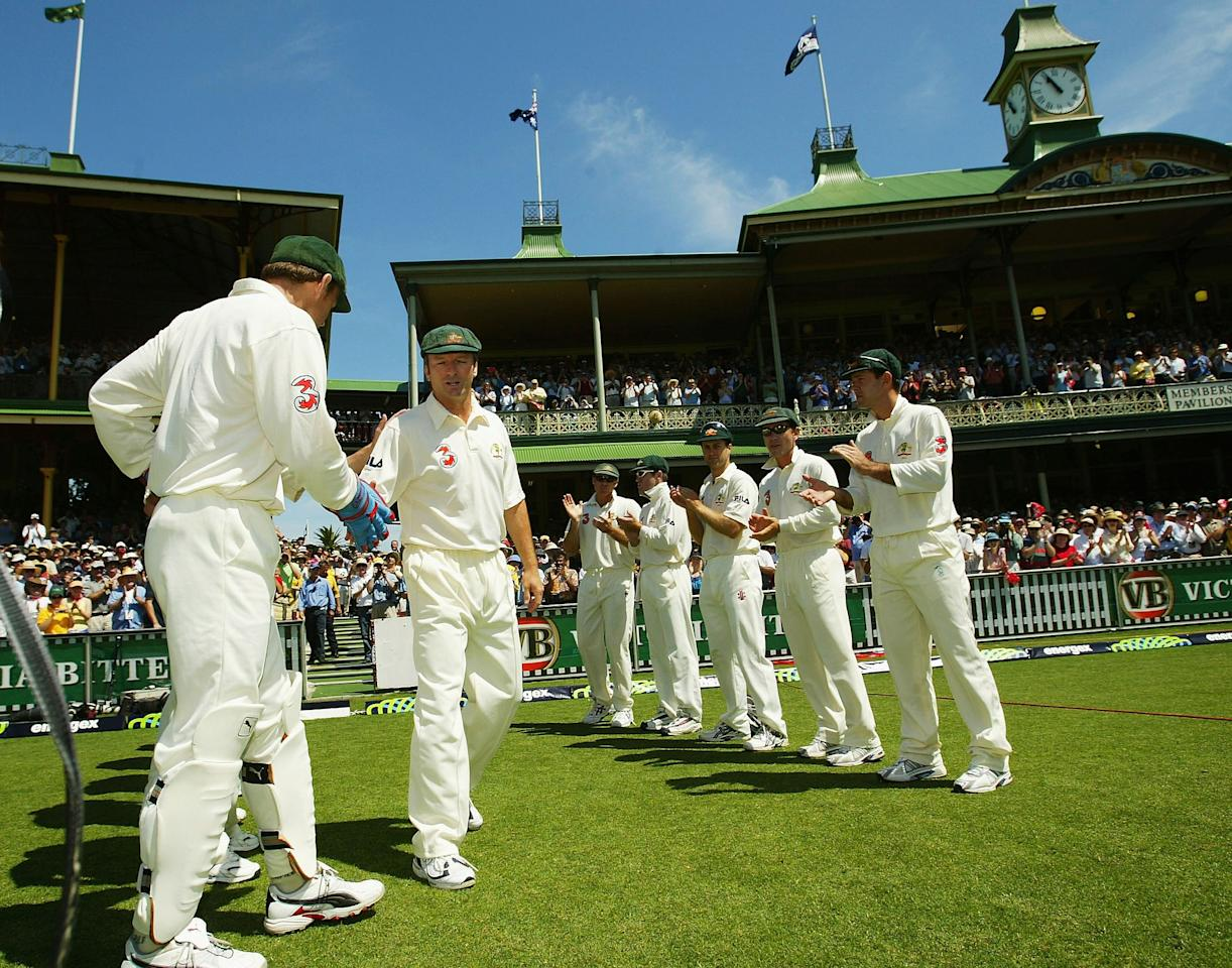 SYDNEY, AUSTRALIA - JANUARY 2:  Steve Waugh of Australia walks out to a guard of honour from his teammates during day one of the 4th Test between Australia and India at the SCG on January 2, 2004 in Sydney, Australia.  (Photo by Hamish Blair/Getty Images)