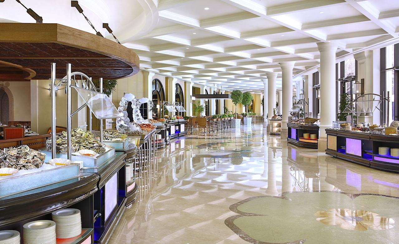 """<p><strong>Tell us about your first impressions when you arrived.</strong> Descending the <a href=""""https://www.cntraveler.com/hotels/united-arab-emirates/abu-dhabi/ritz-carlton-abu-dhabi?mbid=synd_yahoo_rss"""">Ritz-Carlton's</a> grand marble staircase from the lobby to the lower level is only the beginning of the Giornotte experience—but it makes for quite the dramatic entrance. Evolving entertainment acts like Latin dancers and DJs bump up the typical brunch experience a few notches. Outside, a wood-and-brick patio overlooks a garden.</p> <p><strong>What was the crowd like?</strong> Giornotte feels like a convention for brunch fanatics. The patrons here consider brunch the most important meal of the day, and the dress is smart-casual.</p> <p><strong>What do they have to drink?</strong> Seven stations are dedicated just to drinks: juices, smoothies, coffee, and alcoholic beverages as well.</p> <p><strong>Main event: the food. Give us the lowdown—especially what not to miss.</strong> Live stations and buffets highlight breakfast favorites from around the globe—from China to Indonesia to Mexico to France. A seafood station presents mussels, shrimp, and oysters with lemon over ice, as well as crab remoulade and sesame-crusted ahi tuna. And there's no shortage of dessert, like house-made pistachio biscotti and traditional Arabic sweets.</p> <p><strong>How was the staff?</strong> The staff is always busy restocking the buffet stations, but if you need assistance they're more than happy to help.</p> <p><strong>What's the real-real on why we're coming here?</strong> This certainly earns its keep as a special brunch destination for occasions like birthdays or anniversaries.</p>"""