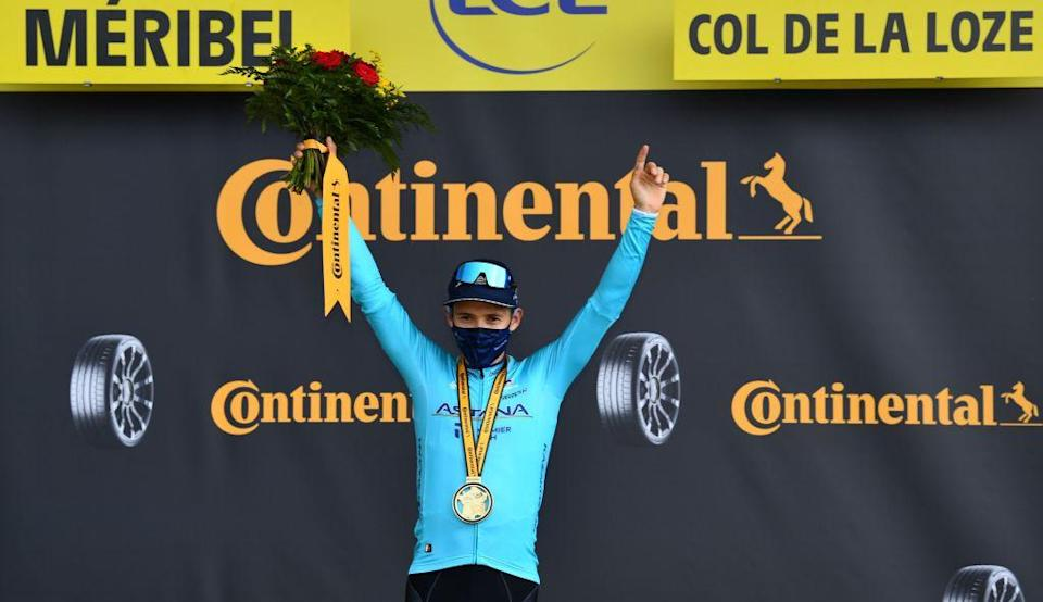 Stage winner Team Astana rider Colombias Miguel Angel Lopez celebrates on the podium after winning atop the Loze pass Col de la Loze at the end of the 17th stage of the 107th edition of the Tour de France cycling race 170 km between Grenoble and Meribel on September 16 2020 Photo by Stuart Franklin  POOL  AFP Photo by STUART FRANKLINPOOLAFP via Getty Images