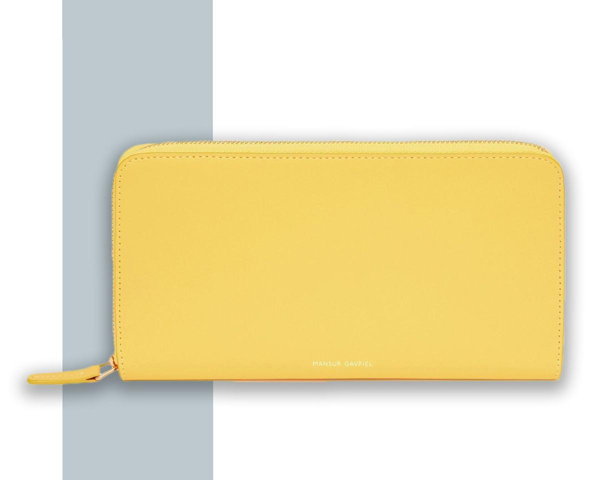 """<p>For the frequent flier with a credit card for every <a href=""""https://www.cntraveler.com/story/best-credit-cards-for-transferrable-points?mbid=synd_yahoo_rss"""">points-earning scenario</a>, this sunny Italian-made wallet from fashion's cult-favorite brand has all the trimmings—eight card slots, two bill pockets, and a zip pocket. (If you're looking for something with a little less bulk, go for <a href=""""https://fave.co/2MXuQt9"""" rel=""""nofollow"""">this half-moon style wristlet</a> with only two card slots and a single bill pocket.)</p> <p><strong>Buy Now</strong>: <a href=""""https://fave.co/2ZSC3hQ"""" rel=""""nofollow"""" target=""""_blank"""">$395, mansurgavriel.com</a></p>"""