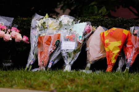 Flowers are placed an impromptu memorial at the Tree of Life synagogue following Saturday's shooting at the synagogue in Pittsburgh Pennsylvania