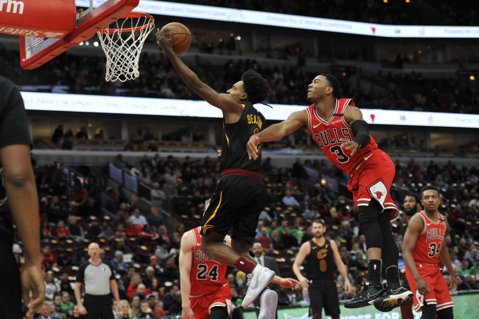 Cleveland Cavaliers' Collin Sexton (2) goes up for a shot past Chicago Bulls' Shaquille Harrison (3) during the first half of an NBA basketball game Tuesday, March 10, 2020, in Chicago. (AP Photo/Paul Beaty)