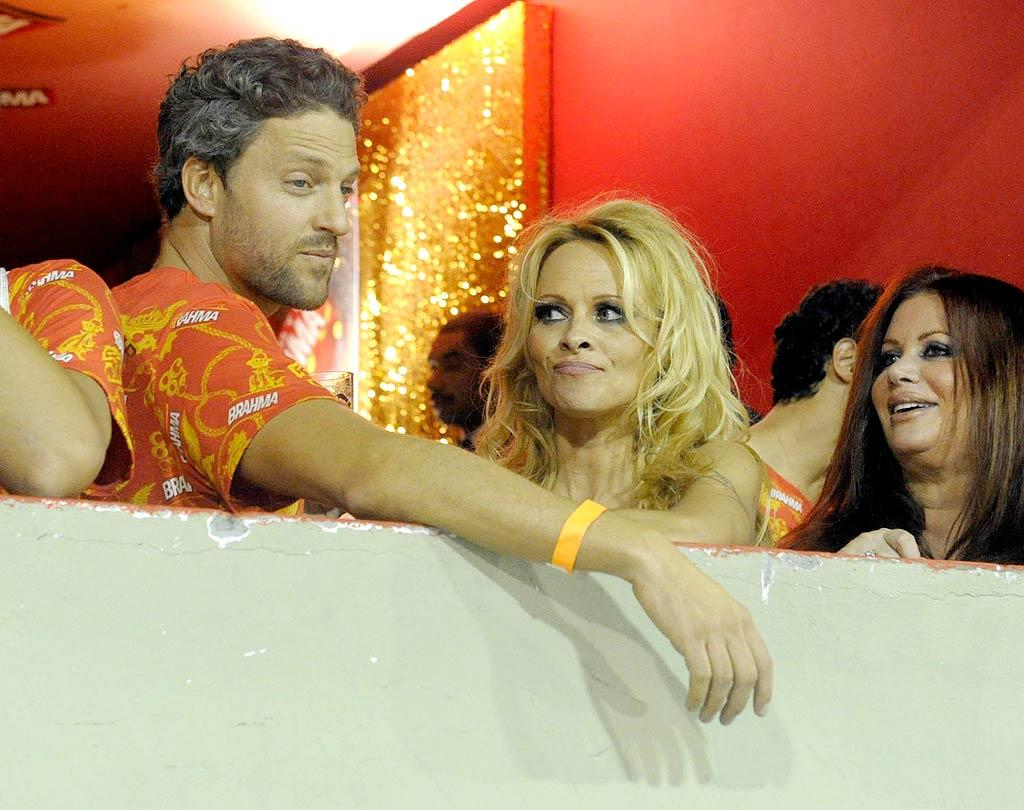 """Pamela Anderson scored a seat in an exclusive box to view the extravagant Mardis Gras parade, which attracts over 80,000 people each year. The event also employs around 50,000 police to keep crime to a minimum during the festivities. IG.COM.BR/<a href=""""http://www.splashnewsonline.com"""" target=""""new"""">Splash News</a> - March 6, 2011"""