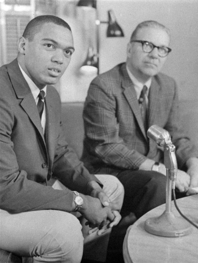 FILE - In this June 1966, file photo, Reggie Jackson, left, an outfielder from Arizona State, and the Kansas City Athletics No. 1 pick in the baseball draft, sits with team's executive vice president, Ed Lopat, after signing a contract for $85,000 in Kansas City, Mo. Baseballs amateur draft this week will look much different because of the coronavirus pandemic, and more permanent changes could be coming soon. (AP Photo/File)