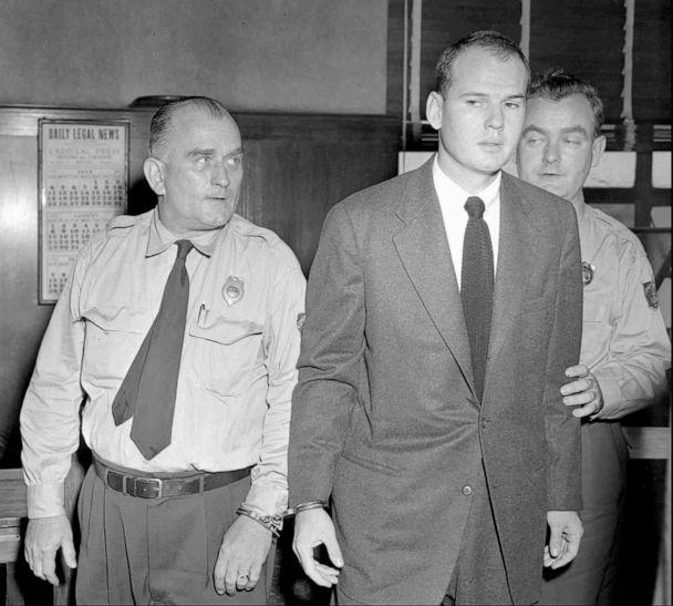PHOTO: Dr. Sam Sheppard, accompanied by law officers, returns to his jail cell in Cleveland on Dec. 21, 1954, after a jury found the 30-year-old osteopath guilty of killing his wife. (AP)