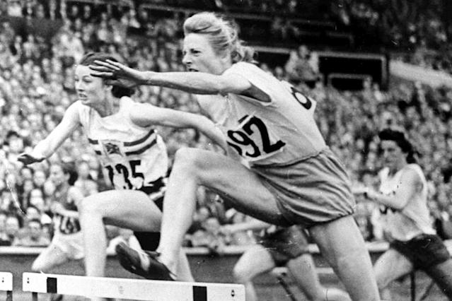 FILE - In this Aug. 4, 1948, file photo, Fanny Blankers-Koen of Holland,, leaps the last hurdle in the women's Olympic Games 80-metres hurdles Final at Wembley Stadium in London. Blankers-Koen was 30, the oldest woman among the track and field entries and considered past her prime. But she won the 100 and 200 meters, the 80-meter hurdles and the 4x100-meter relay. She remains the only female track and field athlete to win four gold medals at a single Olympics. (AP Photo/File)