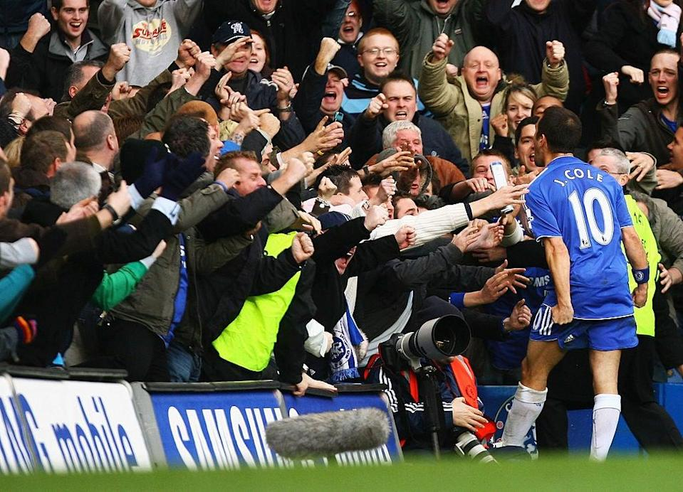 <p>Joe Cole celebrates in front of the fans at Stamford Bridge</p>Getty