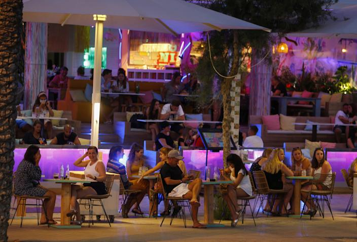 Open touristic bars are seen in the corner of Bierstrasse street (Miquel Pellisa street) in El Arenal beach, where authorities on Wednesday closed all commercial activities to prevent the crowding of tourists, amid the coronavirus disease (COVID-19) outbreak in Palma de Mallorca, Spain, July 15, 2020. Picture taken July 15, 2020.REUTERS/Enrique Calvo