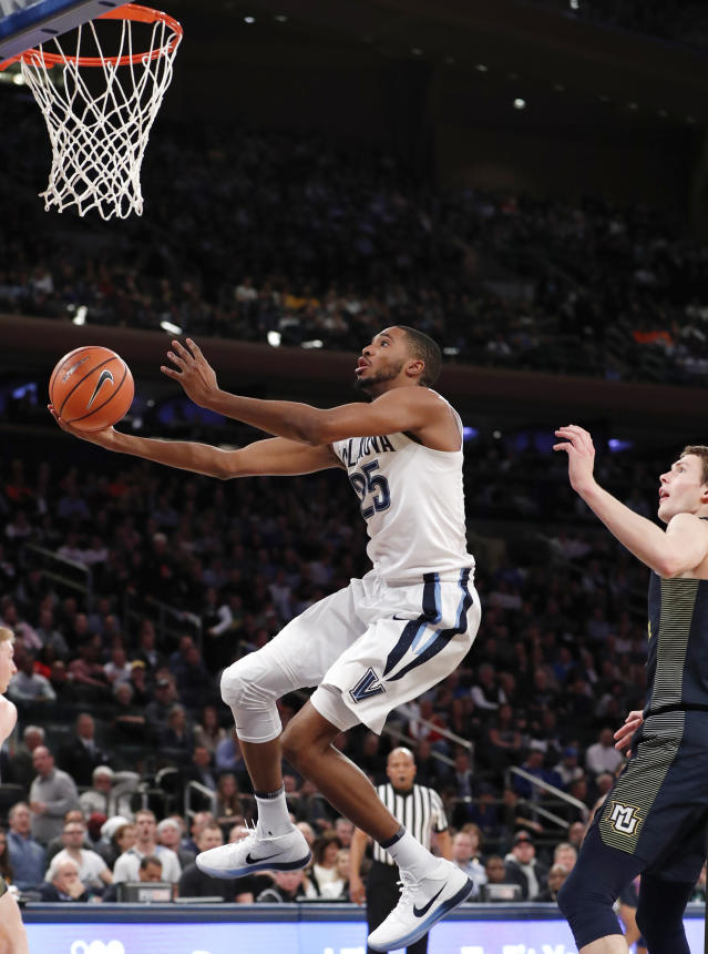 Villanova guard Mikal Bridges (25) shoots in front of Marquette center Matt Heldt during the first half of an NCAA college basketball game in the quarterfinals of the Big East men's tournament in New York, Thursday, March 8, 2018. (AP Photo/Kathy Willens)