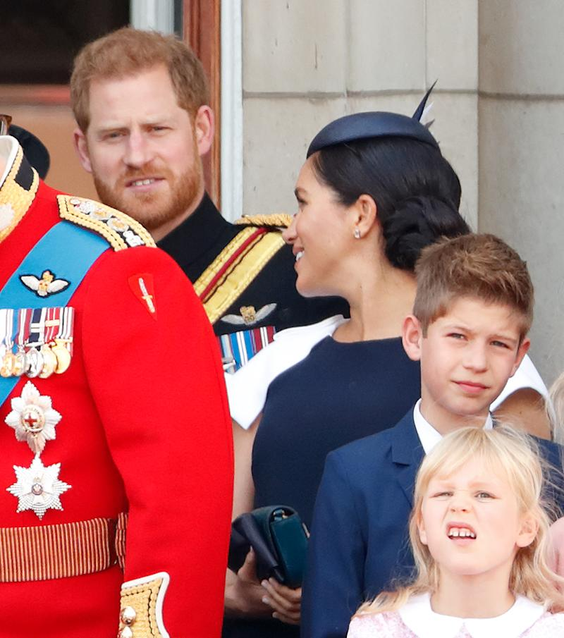 Prince Harry and Meghan Markle talking at Trooping the Colour at Buckingham Palace
