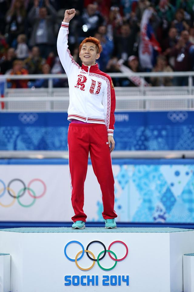 SOCHI, RUSSIA - FEBRUARY 21: Gold medalist Victor An of Russia celebrates during the flower ceremony for the Short Track Men's 500m on the podium during the flower ceremony for the Short Track Men's 500m on day fourteen of the 2014 Sochi Winter Olympics at Iceberg Skating Palace on February 21, 2014 in Sochi, Russia. (Photo by Matthew Stockman/Getty Images)