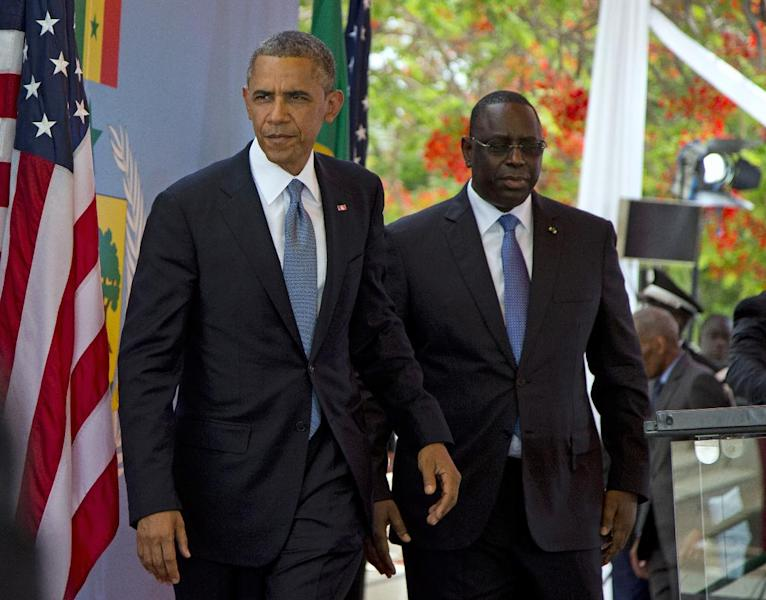 President Barack Obama and Senegalese President Macky Sall leave after a news conference at the Presidential Palace in Dakar, Senegal Thursday, June 27, 2013. Obama is visiting Senegal, South Africa, and Tanzania on a week long trip. (AP Photo/Evan Vucci)