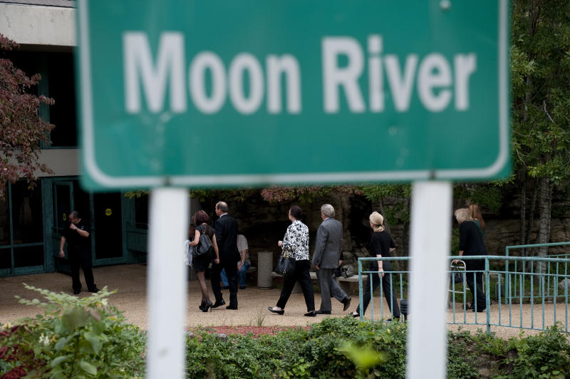 "Patrons of Andy Williams' memorial service walk to the Moon River Theater, in Branson, Mo., Sunday, Oct. 21, 2012. Williams, known for singing ""Moon River"" and his Christmas television specials, passed away Sept. 25. (AP Photo/Grant Hindsley)"