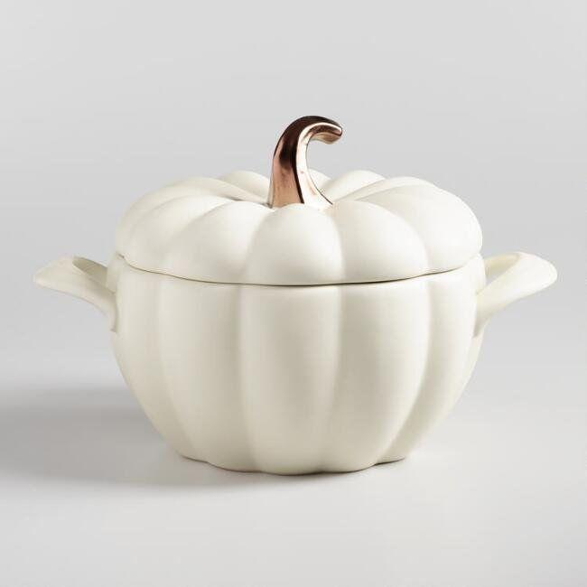 "This <a href=""https://www.worldmarket.com/product/matte+white+ceramic+pumpkin+casserole+baker.do?sortby=ourPicks&from=Search"" target=""_blank"">festive ceramic dish</a> features a lid to retain moisture and side handles for easy carrying."