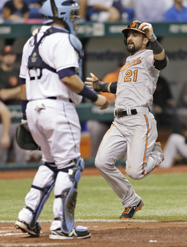 Baltimore Orioles' Nick Markakis (21) scores on a fourth-inning RBI single by J.J. Hardy off Tampa Bay Rays starting pitcher Chris Archer during a baseball game Monday, Sept. 23, 2013, in St. Petersburg, Fla. Catching for the Rays is Jose Molina. (AP Photo/Chris O'Meara)