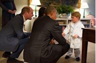 <p>Prince George sports a personalized bathrobe while meeting U.S. President Barack Obama and First Lady Michelle Obama at Kensington Palace, with Kate Middleton and Prince William looking on.</p>