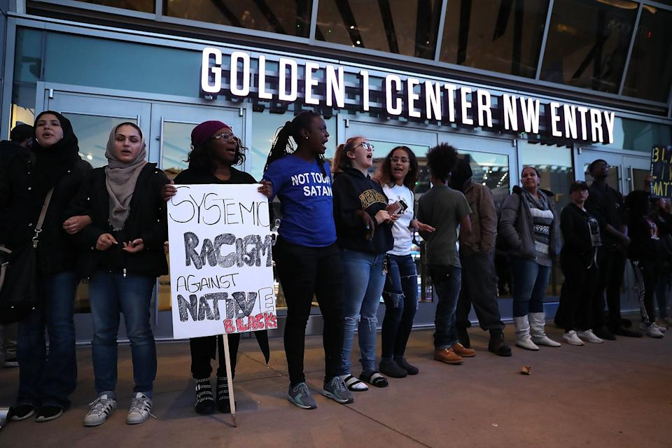 Protesters chant as they block the entrance to the Golden 1 Center.