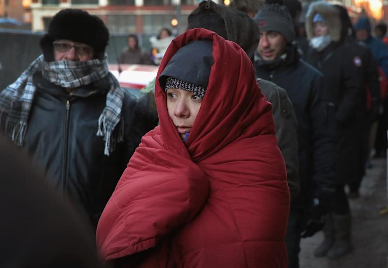 People wait in line, most for two or more hours, in sub-zero wind chill temperatures outside McCormick Place to get tickets for President Barack Obama's speech (AFP Photo/Scott Olson)