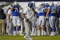 BYU coach Kalani Sitake speaks with officials during the first half of the team's NCAA college football game against Louisiana Tech on Friday, Oct. 2, 2020, in Provo, Utah. (AP Photo/Rick Bowmer, Pool)