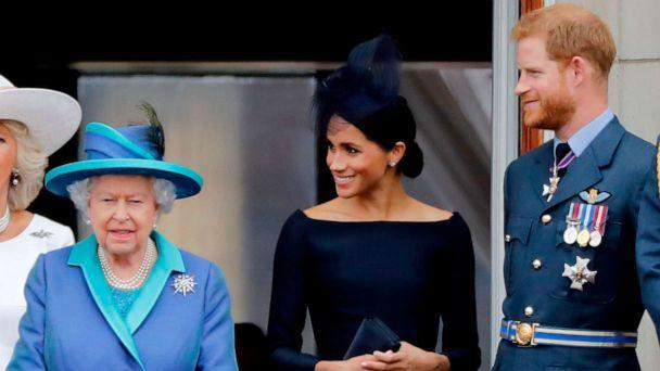 PHOTO: In this July 10, 2018, file photo, Queen Elizabeth II, Meghan, Duchess of Sussex, and Prince Harry, Duke of Sussex stand on the balcony of Buckingham Palace in London to watch a military fly-past to mark the centenary of the Royal Air Force. (Tolga Akmen/AFP via Getty Images, FILE)