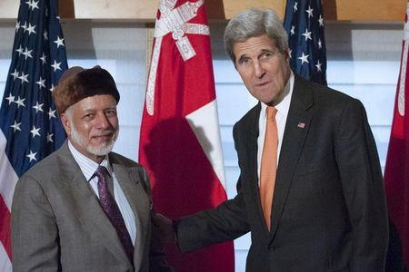 United States Secretary of State John Kerry (R) shakes hands with Foreign Minister Yusuf bin Alawi bin Abdullah of Oman as they pose for photos at the Palace Hotel in New York