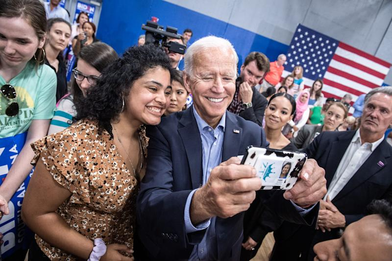 Supporters of former Vice President Joe Biden pose for cell phone photos with him following his town hall event at the Staunton Bridge Community Center Thursday, August 29, 2019.