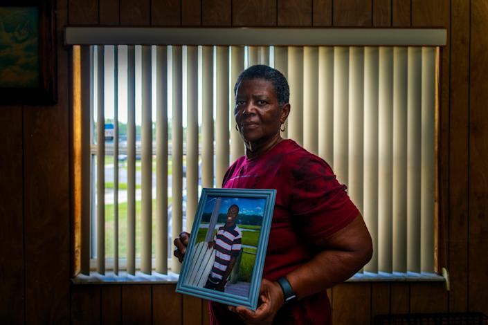 Cynthia Green, holds a photograph of her adoptive son, Sincere Pierce, at her home in Cocoa, Fla., on May 6, 2021. Pierce was 18 years old when he was shot and killed by a Brevard, Fla., deputy in November.