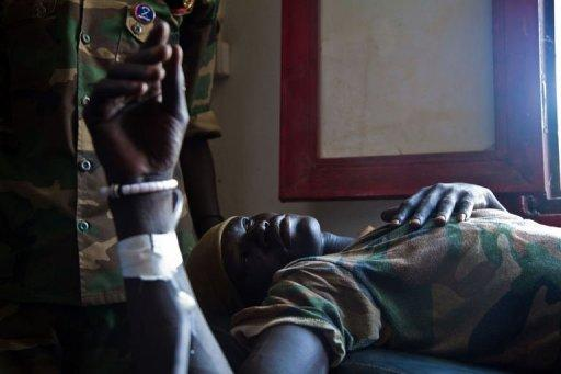 A wounded soldier of the South-Sudan's Sudan People's Liberation Army (SPLA) is treated at the Rubkona Military Hospital in Rubkona, South Sudan. South Sudan's army said on Sunday it had completed its pullout from an oil field seized from Sudan, ending a deadly standoff which forced thousands of civilians to flee