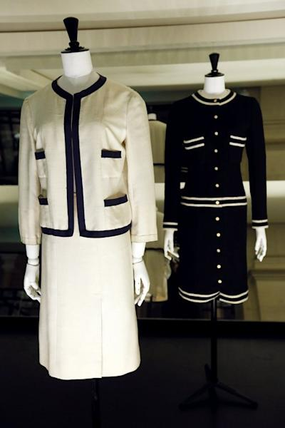 Two Chanel outifts are displayed at the storage of the Galliera fashion museum in Paris, on February 25, 2013. A landmark exhibition due to open in Paris on Saturday traces the history of haute couture through some of the most exquisite dresses ever made
