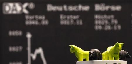 Foam figure of bulls and bears are seen in front of the German share prize index DAX board at the stock exchange in Frankfurt