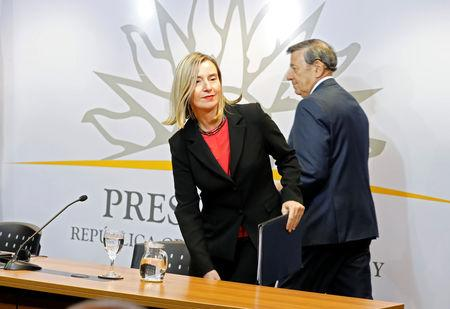 """Federica Mogherini, High Representative of the Union for Foreign Affairs and Security Policy and Uruguayan Foreign Minister Rodolfo Nin Novoa arrive to attend a news conference after a meeting of European and Latin American leaders in Montevideo to discuss """"good faith"""" plan for Venezuela, Uruguay February 7, 2019. REUTERS/Andres Stapff"""