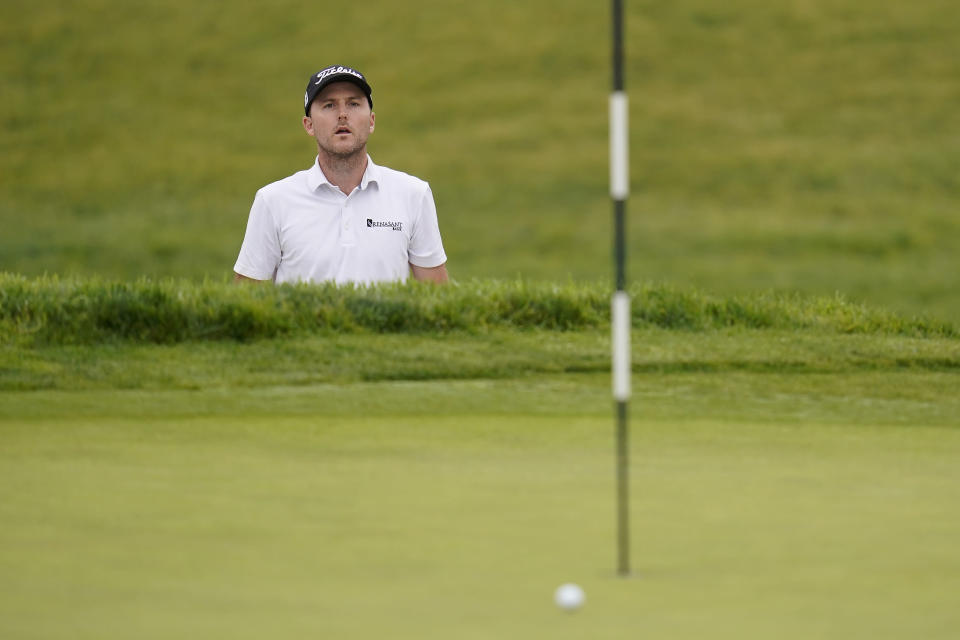 Russell Henley watches his shot on the first green roll wide of the cup during the first round of the U.S. Open Golf Championship, Thursday, June 17, 2021, at Torrey Pines Golf Course in San Diego. (AP Photo/Gregory Bull)
