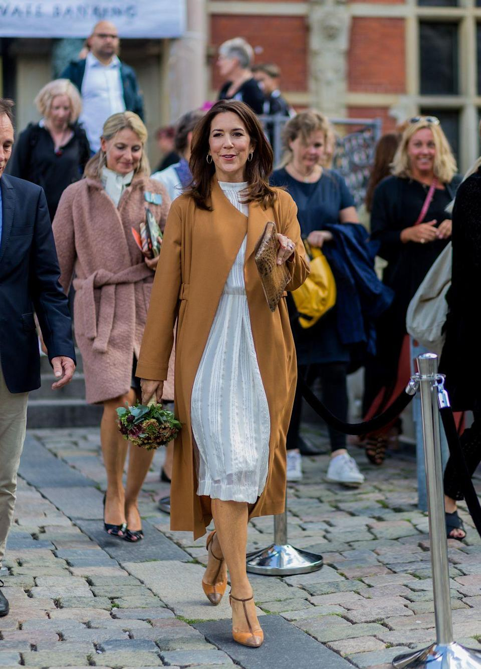 <p>While she's known for her personal style and is a supporter of Denmark's third largest export, fashion (she's pictured here at Copenhagen Fashion Week, the Princess has always maintained an air of approachability; Copenhagen residents often see her riding around on her bike with her four children. </p>