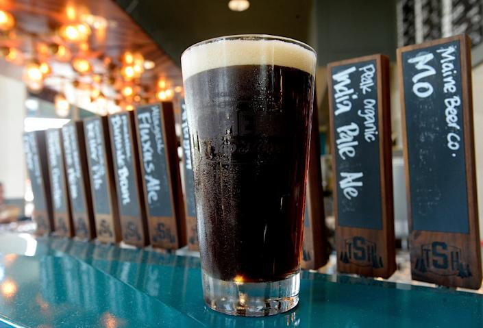 """<strong>Flavor:</strong>Brown ales have a higher level of malt, which makes them more earthy and less bitter. Flavors vary from sweet, to slightly hoppy, to earthy and malty.<br /><br /><strong>Color:</strong> Dark, dark amber.<br /><br /><strong>Strength: </strong>4-8 percent ABV<br /><br /><strong>Fun Fact:</strong>It's a very old style beer, <a href=""""https://www.anchorbrewing.com/blog/brekles-and-a-brief-history-of-brown/"""" target=""""_blank"""">dating back to the early 1700s</a>."""