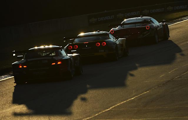 Jorg Muller (55), of Germany, follows Oliver Gavin (4), of England, and Matteo Malucelli (62) during the American Le Mans Series' Petit Le Mans auto race at Road Atlanta, Saturday, Oct. 19, 2013, in Braselton, Ga. (AP Photo/Rainier Ehrhardt)