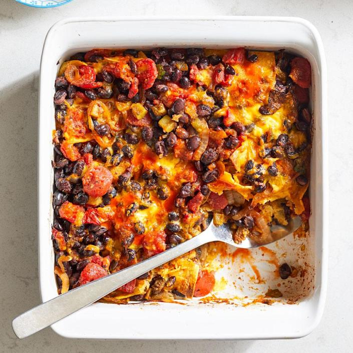 <p>This layered casserole is inspired by classic cheese enchiladas, minus the fuss of rolling and stuffing individual tortillas. You'd never guess that within this comforting Tex-Mex casserole hides a layer of thinly sliced eggplant. The thin slices become tender when roasted and add a subtle savory note.</p>