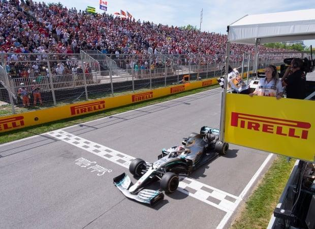 Mercedes driver Lewis Hamilton of Great Britain crosses the finish line to win the Canadian Grand Prix in 2019, the last year the race was held. (Paul Chiasson/The Canadian Press - image credit)