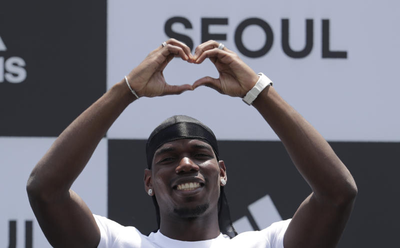 Manchester United's soccer player Paul Pogba, poses for the media during a media day in Seoul, South Korea, Thursday, June 13, 2019. Pogba is in Seoul as a part of his Asian tour. (AP Photo/Lee Jin-man)
