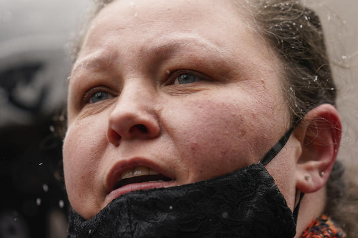 Katie Wright, center, mother of Daunte Wright, speaks during a news conference in snowfall, Tuesday, April 13, 2021, in Minneapolis. Daunte Wright, 20, was shot and killed by police Sunday after a traffic stop in Brooklyn Center, Minn. (AP Photo/John Minchillo)