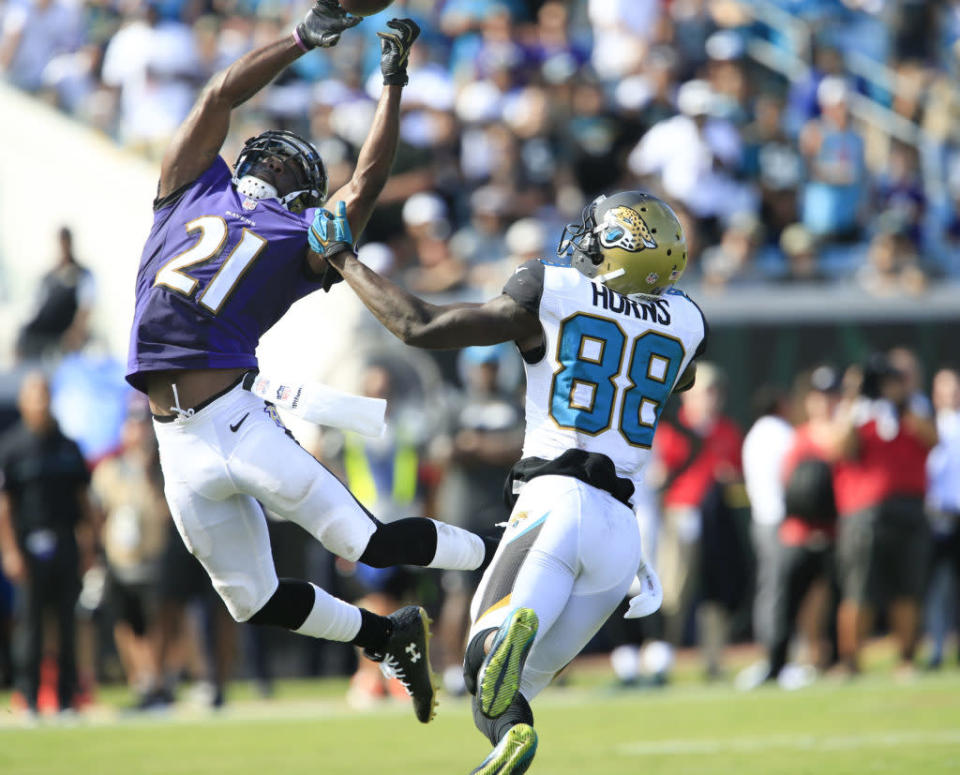 Sep 25, 2016; Jacksonville, FL, USA; Baltimore Ravens free safety Lardarius Webb (21) tips the ball to his teammate causing an interception as Jacksonville Jaguars wide receiver Allen Hurns (88) looks on during the second half of a football game at EverBank FieldThe Baltimore Ravens won 19-17. Mandatory Credit: Reinhold Matay-USA TODAY Sports