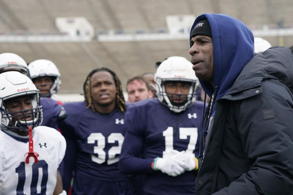 Jackson State football coach Deion Sanders speaks with players following an NCAA college football scrimmage in Jackson, Miss., Saturday, Feb. 13, 2021. This is Sanders' first college head coaching position. (AP Photo/Rogelio V. Solis)