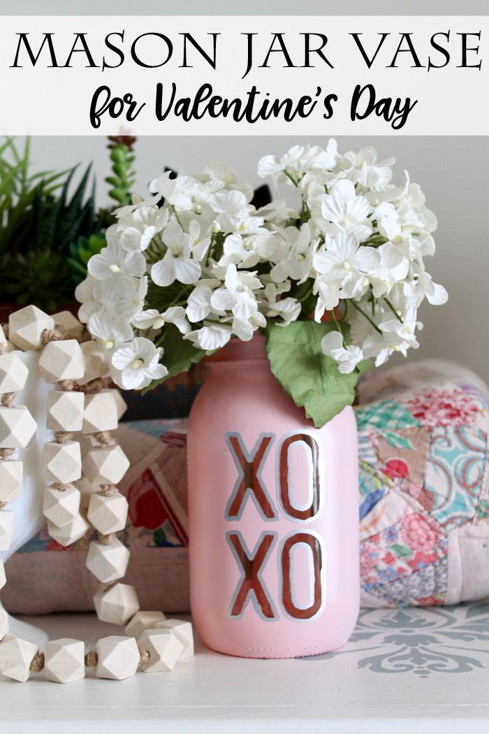 """<p>Spray paint this pastel pink mason jar vase for a beautiful display of your Valentine's Day flowers.</p><p><strong>Get the tutorial at <a href=""""https://www.thecountrychiccottage.net/mason-jar-vase-for-valentines-day/"""" rel=""""nofollow noopener"""" target=""""_blank"""" data-ylk=""""slk:The Country Chic Cottage"""" class=""""link rapid-noclick-resp"""">The Country Chic Cottage</a>.</strong></p><p><a class=""""link rapid-noclick-resp"""" href=""""https://www.amazon.com/Rust-Oleum-301537-Universal-Metallic-Champagne/dp/B01J3YYX1K/ref=sr_1_4?tag=syn-yahoo-20&ascsubtag=%5Bartid%7C10050.g.93%5Bsrc%7Cyahoo-us"""" rel=""""nofollow noopener"""" target=""""_blank"""" data-ylk=""""slk:SHOP SPRAY PAINT"""">SHOP SPRAY PAINT</a><strong><br></strong></p>"""