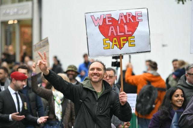 Protesters during an anti-lockdown rally (Dominic Lipinski/PA)